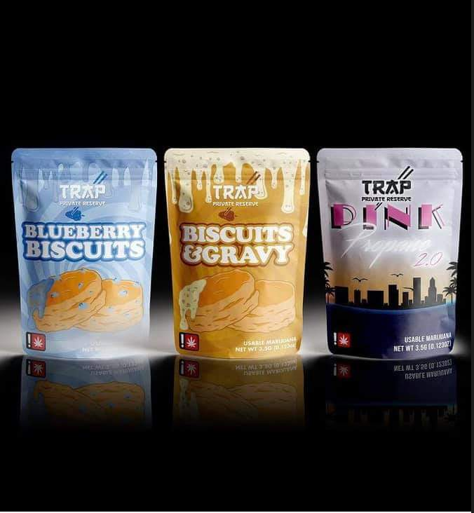 Packaging of Blueberry Biscuits, Biscuits & Gravy, and Pink packages from Trap Kitchen Reserve